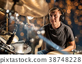 musician playing drum kit at concert over lights 38748228