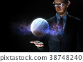 close up of businessman with planet hologram 38748240