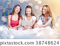 happy friends or teen girls with tablet pc at home 38748624