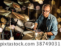 male musician playing drums and cymbals at concert 38749031