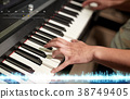 hands playing piano at sound recording studio 38749405