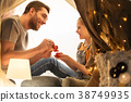 family playing tea party in kids tent at home 38749935