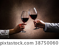 toasting with wine glasses 38750060