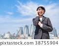 Young woman in suit wearing a helmet on the phone 38755904