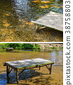 Empty patio furniture at garden in the river 38758803