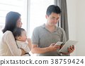 Asian family scanning QR code 38759424