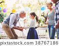 Family celebration or a garden party outside in 38767186