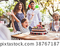Family celebration or a garden party outside in 38767187