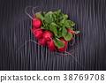 Vegetable radish for salad on a wooden black board 38769708