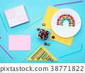 Colorful still life with sweets and present on 38771822