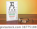 Eye Chart and Glasses on the wooden table 38775188