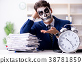 Businessmsn with scary face mask working in office 38781859