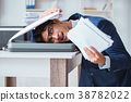 Businessman making copies in copying machine 38782022
