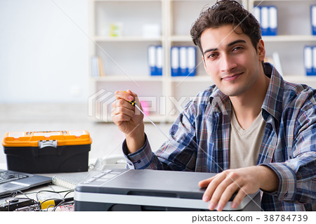 Hardware repairman repairing broken printer fax 38784739