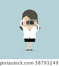 Businesswoman takes a picture with camera. 38793249