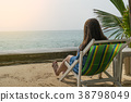 woman sitting and relax on deckchair in vacation 38798049