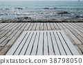 wooden beach chair on the floor at seaside 38798050