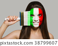 Female supporter in national colors of Italy 38799607