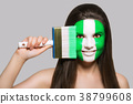 Female supporter in national colors of Nigeria 38799608