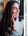 beautiful smiling brunette woman in sweater 38800337