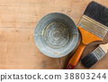 old zinc bucket and paintbrush on wooden board. 38803244
