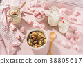 Breakfast set. mix oat granola in white bowl with pink heart sweet marshmallow on teble set background, serve with white milk in glass and Bottle, top view, Healthy food concept 38805617