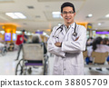 Portrait of Asian Doctor with the stethoscope equipment over Abstract photo blurred of hospital background, Patient sitting chair with waiting seat for see doctor, Hospital and physician concept 38805709
