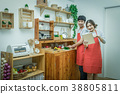 Happy Asian Lover or couple cooking and following the tutorial in technology tablet with happiness action in the kitchen room at the modern house, Couple and life style concept. 38805811