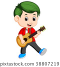 Happy boy playing on acoustic guitar 38807219