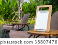 Empty menu frame standing on wood table  38807478