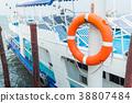 Orange lifebuoy , Safety equipment, at the pier 38807484