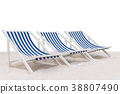 Blue and white striped beach chair on the sand 38807490
