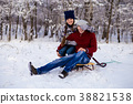 Love couple playing outdoors in winter snow park 38821538