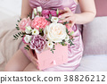 Young dreaming woman holding Square Pink Flower 38826212