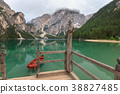 Boat tethered on stairway at Lake Braies boathouse 38827485