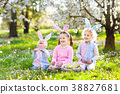 Easter egg hunt. Kids with bunny ears and basket. 38827681
