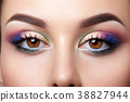 Closeup view of woman eyes with evening makeup 38827944