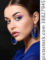 Portrait of beautiful woman with fashion makeup 38827945