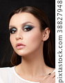 Portrait of beautiful woman with fashion makeup 38827948