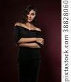 Young beautiful woman wearing black evening dress 38828060