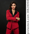 Young beautiful woman wearing red suit 38828068