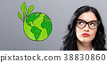 Green Earth with young businesswoman 38830860