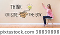 Think Outside The Box with young woman holding a 38830898