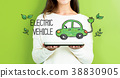 Electric Vehicle with woman holding a tablet 38830905