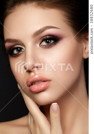 Young beautiful woman with evening make up 38832680