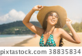 Asian woman on beach are posted to take a photo 38835834