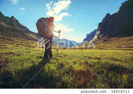hiking in sunrise high altitude mountains 38838552