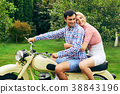 beautiful couple on retro motorbike 38843196