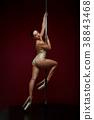 beautiful pole dancer in golden bodywear on pylon 38843468