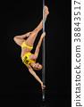 beautiful pole dancer in yellow costume on pylon 38843517